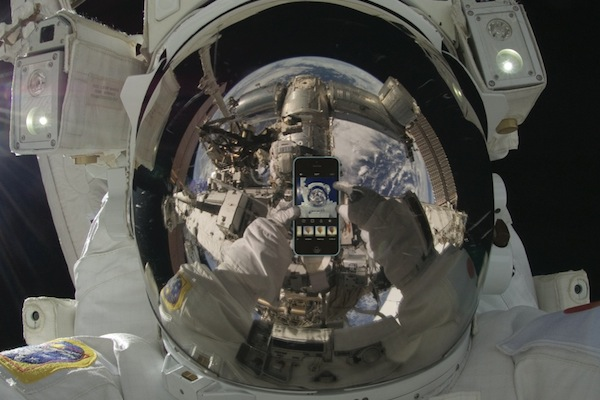An astronaut taking a selfie. Note: This image has been digitally altered. The astronaut did take a selfie, but not with an iPhone.