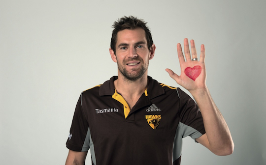 hawks player with heart drawn on hand