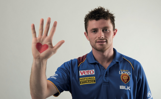 lions player  with heart drawn on hand